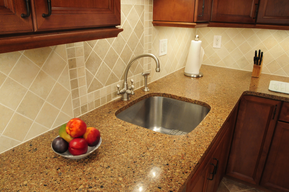 Stainless steel sink in a remodeled kitchen